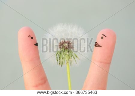 Fingers Art Of Happy Couple. Man Is Giving Flowers To Woman.