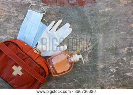 First Aid Kit On Wooden Background. Concept Of Protect Yourself From Covid-2019. Top View.