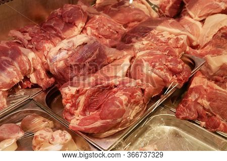 Fresh Raw Pork Meat Lies On The Counter. A Wide Range Of Pork In A Butcher's Shop. An Abundance Of B