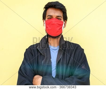 Photo Of A Young Indian Guy Wearing A Face Mask To Protect Against The Coronavirus During Lockdown W