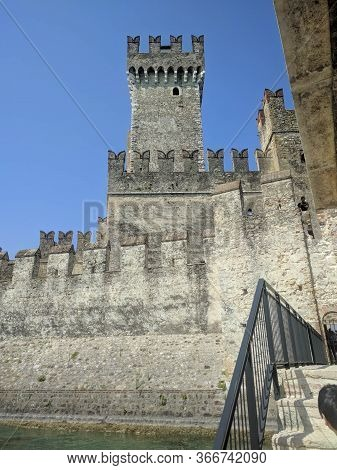 Italy, Lombardy - August 05 2018: The View Of Scaliger Castle On August 05 2018 In Sirmione, Italy.