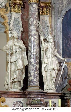 ZAGREB, CROATIA - NOVEMBER 12, 2012: Saints Joseph and Catherine of Alexandria statue on the main altar in the Franciscan church of St. Francis Xavier in Zagreb, Croatia