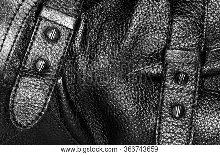 Buckle On A Black Leather Boot