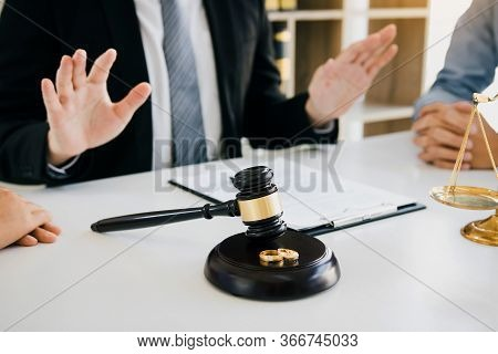 Lawyer Is Telling Him To Calm Down As The Sweetheart Clients Are Going To File For Divorce At The Pr