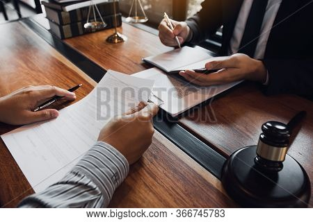 Lawyer Is Providing Information About The Client's Trial At The Lawyer Office.