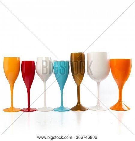 Seven multicolored wine glasses for gourmets. Isolated glasses on wite background for festive events