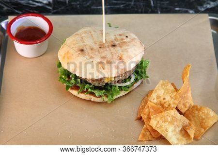 Burger With Meat And Vegetables. Double Cheese Burger. Hot Burger In A Burning Sauce.