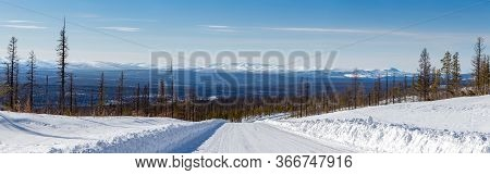 Winter Landscape With Views Of The Mountain Range Zverev, In South Yakutia, Russia