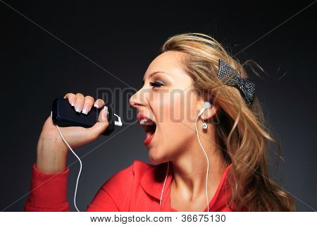 Beautiful woman listening to music
