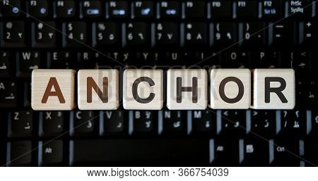 Anchor - Concept Text On Wooden Cubes On Background Black Keyboard