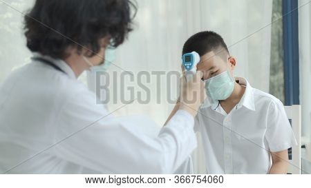 The Doctor Diagnosing Disease For Kid Patient And Wearing Surgical Mask For Health Care From Coronav