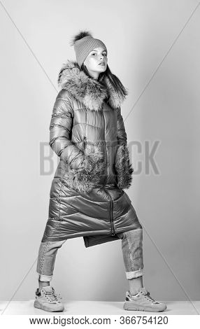 Beauty In Winter Clothing. Cold Season Shopping. Woman In Padded Warm Coat. Girl In Beanie Hat. Faux