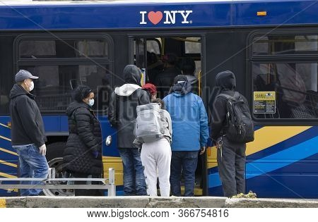 Bronx, New York/usa - April 20, 2020: People Forced To Board Rear Of Mta Bus With No Fare Collection
