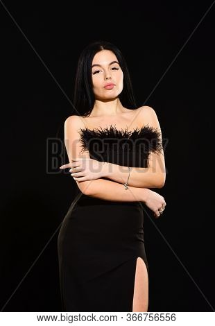 Elegance In Simplicity. Black Is Perfect. Glamorous Style. Feather Decorations. Elegant Woman Fashio
