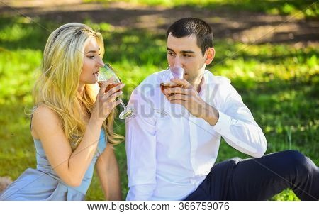 Cheers. Girl And Man Travel Together. Couple In Love Drinking Wine During Romantic Dinner In Park. R