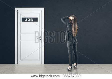 Businesswoman Looking On White Door With Job Sign. Business And Search Job Concept.