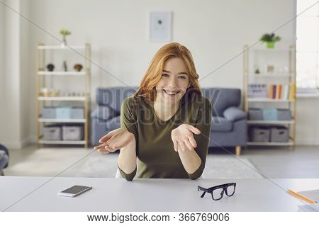 Online Video Blog. A Young Woman Talks Using A Laptop Webinar Webcam Sitting In A Living Room At Hom