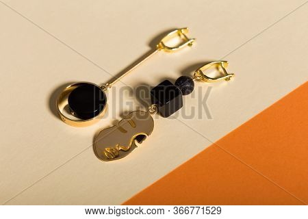 Top View Of Fashion Jewelry And Accessories On Bright Color Background. Luxurious Jewelry Bijouterie