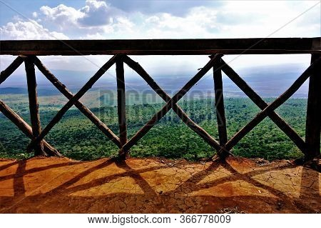 The Majestic Great Rift Valley In Kenya. The Railing Of The Observation Deck Is Wooden, Handmade, Th
