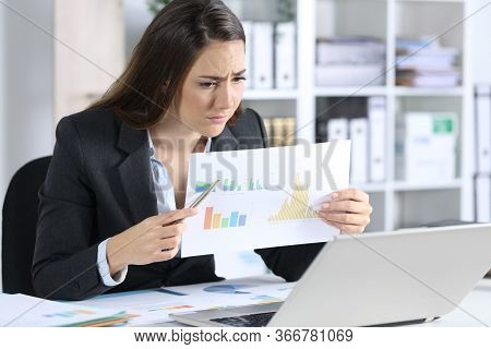 Sad Executive Woman Showing Bad Results Graph Report On Videocall On Aptop Sitting On Her Desk At Of