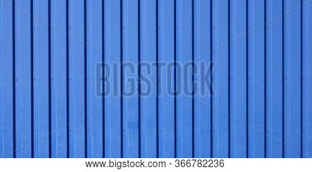Blue Background Of Metal Wall Siding, Cladding. Reflecting Metal Convex Texture. Abstract Ribbed Bac