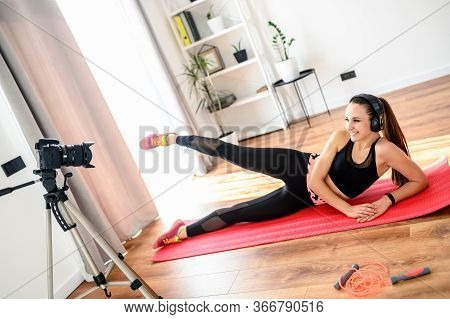 Recording Strenght Video Tutorial At Home. Attractive Slender Girl Is Doing Fitness Exercises And Re