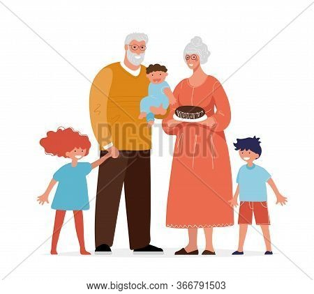 Grandparents Are Standing With Their Grandchildren. Elderly Man And Woman And Small Children, The Co
