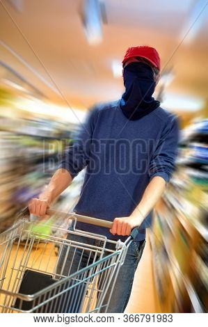 Shopping Man Being So Afraid Of The Coronavirus That He Covers His Whole Face With A Scarf As A Prot
