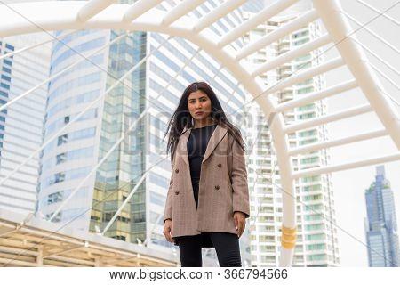 Young Beautiful Indian Businesswoman At The Skywalk Bridge