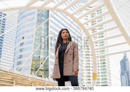 Young Beautiful Indian Businesswoman Thinking At The Skywalk Bridge
