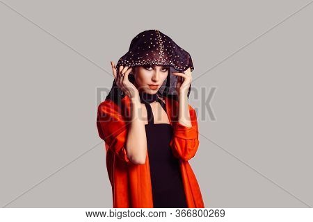 Beautiful Shy Muslim Woman Covering Face With Fashion Veil Isolated On Grey Gray Wall Background. Cl