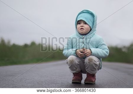 Sad Lonely Little Baby Girl, Upset Abandoned Kid, Lost Child Sitting Or Road, Asphault Or Highway, C