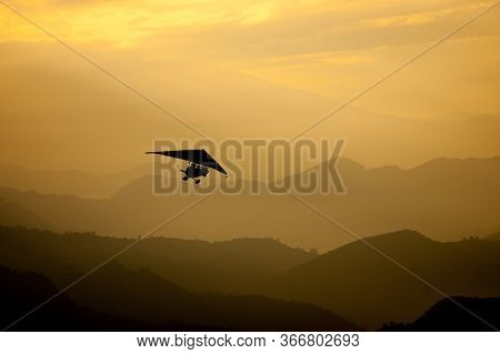 A Small Plane Flying In The Morning Over The Annapurna Range Mountains Of Himalayas. Tourist Compani