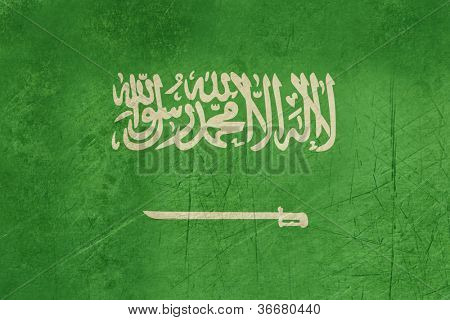 Grunge sovereign state flag of country of Saudi Arabia in official colors.