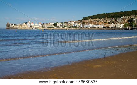 Weston-super-Mare seafront in Somerset England.  A view towards Knightstone Island from the Pier poster