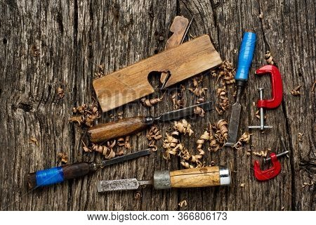 Old Carpenter Tools On Rustic Wood Table Top View.