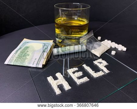 Pills, Us Dollar Banknotes, Whiskey And Cocaine  On A Gray Background. Stop Drugs Concept. A Word