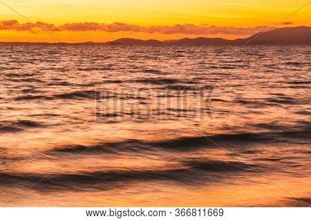 El Arenal beach near Palma de Mallorca in sunset time. Mallorca island, Spain Mediterranean Sea, Balearic Islands.