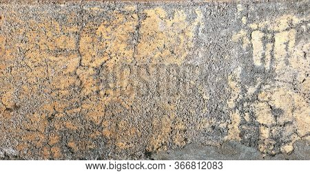 Grunge background with old stucco wall texture of gray, white and yellow color. Hprizontal or vertical banner with texture of ancient stucco. Copy space for text