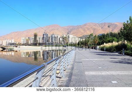 Construction of a modern residential complex on the shore of an artificial lake, Tehran, Iran