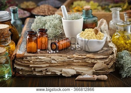 Bottles Of Homeopathic Drugs, Mortars Of Mineral Substances And Medicinal Plants. Infusion Bottles A