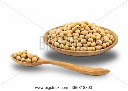 Soy Beans In Wooden Plate And In Wooden Spoon On White Background With Clipping Path.