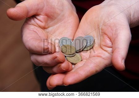 Russian Coins In The Hands Of An Elderly Man. Close-up, Selective Focus. Below The Breadline. Pensio