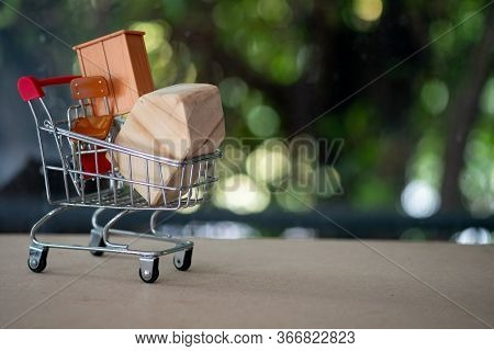 Shopping Cart Full Of Furniture. Concept Of Shopping Furniture For Decoration In House