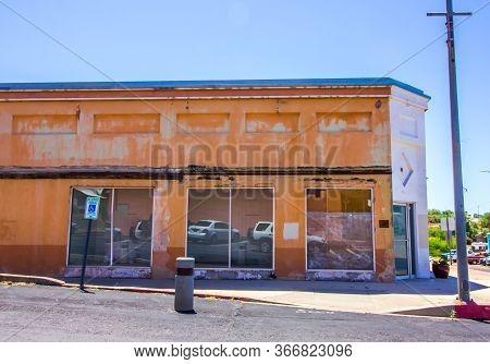 Old Abandoned Corner Retail Building In Disrepair