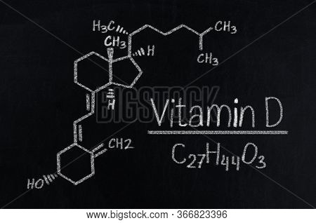 Black Chalkboard With The Chemical Formula Of Vitamin D.