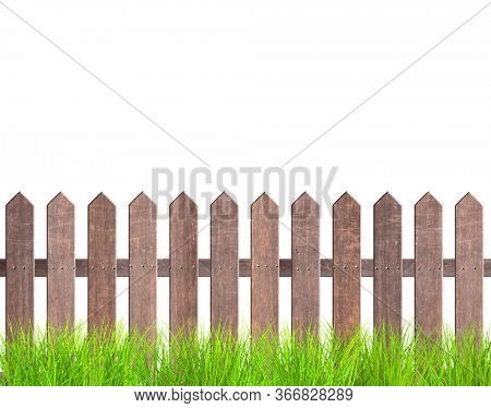 Rustic wooden fence and green grass. Old garden fence with wood planks and with metal rivets. Isolated on white background. 3d render