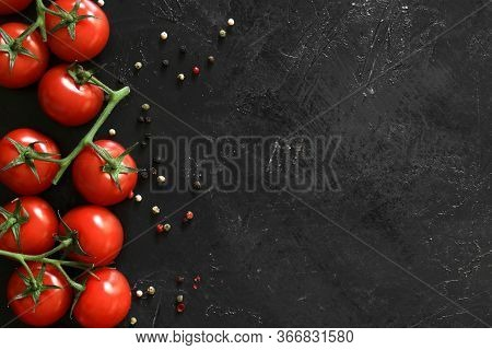 Fresh Tomatoes On A Black Background With . Top View