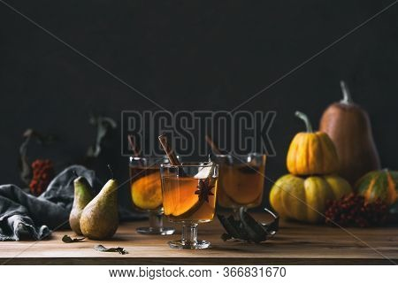 Pear Cider In Glasses Standing On Wooden Rustic Table Front View, Dark Autumn Concept Or Halloween P