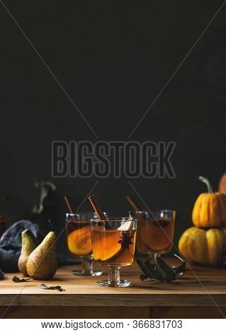 Pear Cider In Glasses Standing On Wooden Rustic Table Front View, Moody Fall Concept With Blank Spac
